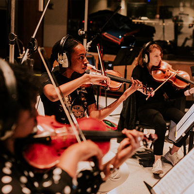 Kaboom Collective musicians play in studio orchestra