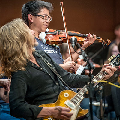 Tommy Shaw performs with youth orchestra